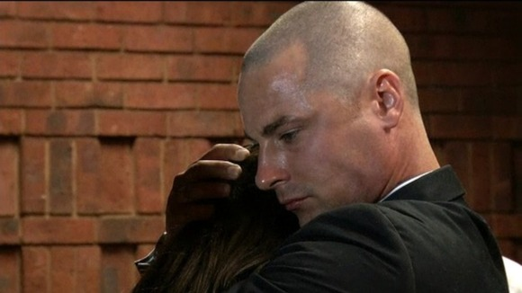 Oscar Pistorius&#x27; brother Carl comforts their sister Aimee in court 
