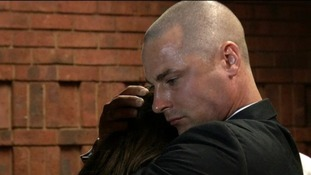 Oscar Pistorius' brother Carl comforts their sister Aimee in court