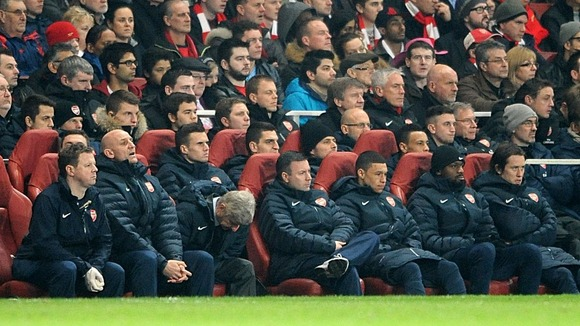 Arsene Wenger hangs his head in despair as Bayern cruise into half-time lead