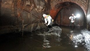workmen in sewer