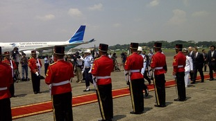 The Prime Minister is welcomed at the airport in Jakarta.