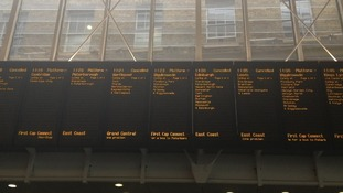 The departure board at King's Cross shows a large number of cancellations this morning