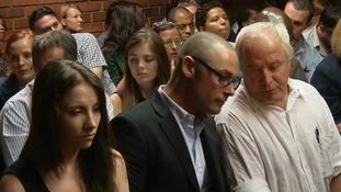 From left: Oscar Pistorius' sister Aimee, brother Carl and father Henke in the courtroom
