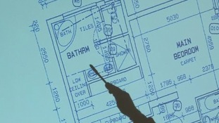 A projection of the floor plan of Oscar Pistorius' bathroom is shown to the court