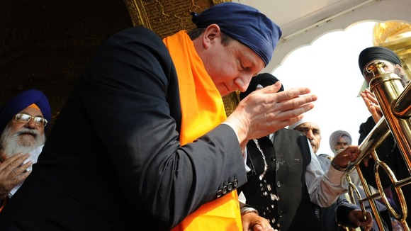 David Cameron is shown around the Golden Temple