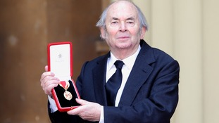 Sir Quentin Blake proudly holds his Knighthood