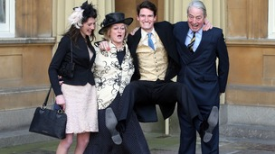 Jumping for joy: Olympic Gold Medalist Peter Wilson with his parents and girlfriend at Buckingham Palace