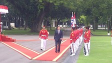 The Prime Minister inspecting Indonesian troops in Jakarta