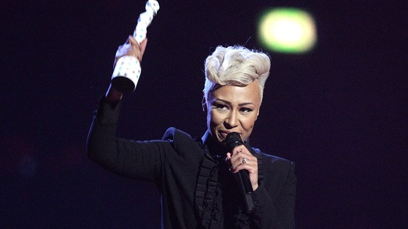 Emeli Sande holds her Brit Award for best British female