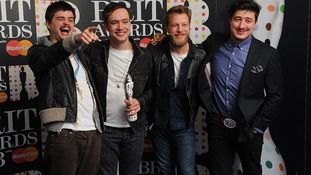 Mumford & Sons celebrate their Brit Award for best British group