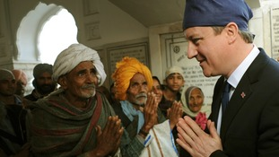 Prime Minister David Cameron in the Golden Temple at Amritsar, Punjab, yesterday.