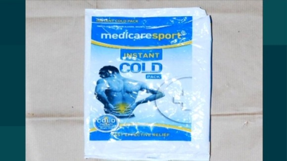 A sports coldpack wrapper found inside the house