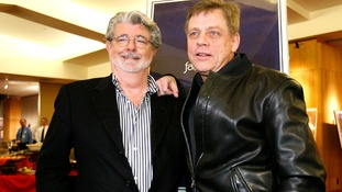 Writer and director George Lucas poses with Mark Hamill at the 30th anniversary screening of Star Wars