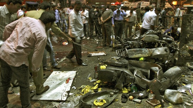 Police examine the site of an explosion in the southern Indian city of Hyderabad