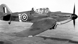 1940: Squadron Leader John Betty, an instructor with No 8 Flight Training School in the raised seat of a Miles Master