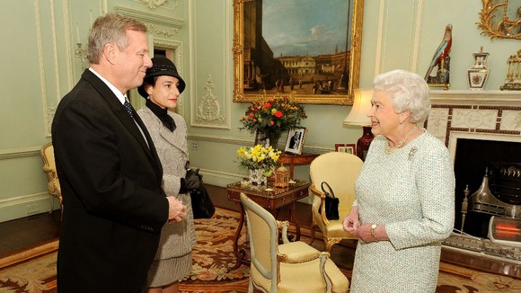 The Queen with the High Commissioner of Australia. In the background an electric fire.