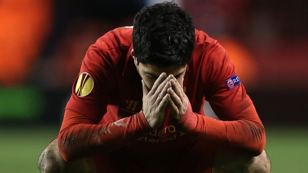 Liverpool's Luis Suarez shows his dejection after the final whistle