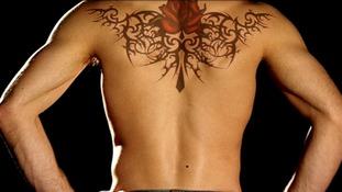 Tattoo across a man's back