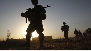 US army soldiers patrol in the village of Chariagen in the  Panjwai district of Kandahar province