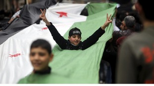 A brief smile from a boy of the Syrian opposition