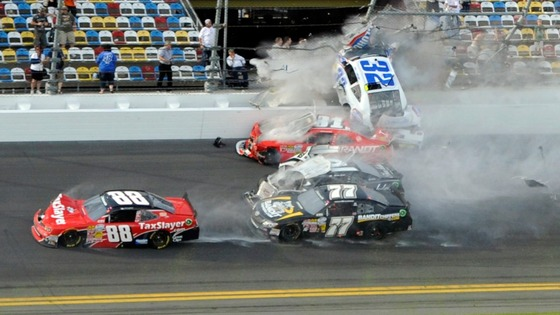 NASCAR driver Kyle Larson (32) and his Chevrolet end up in the fence during the final lap crash