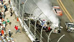 DATE IMPORTED:February 24, 2013NASCAR driver Kyle Larson (32) and his Chevrolet end up in the fence during the final lap crash
