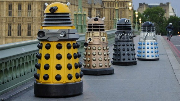 Four generations of Daleks crossing Westminster Bridge in London