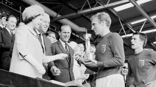 Bobby Moore collects the Jules Rimet Trophy from the Queen after England's 1966 victory