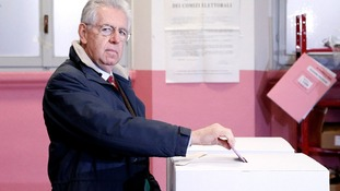 Mario Monti casts his vote at a polling booth in Milan