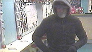 Police hunt bookies robber