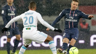 2013Paris Saint-Germain's David Beckham (R) challenges Olympic Marseille's Jacques-Alaixys Romao during their French Ligue 1 football match
