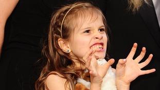 Claudio Miranda's daughter Sofia pulls faces at the cameras
