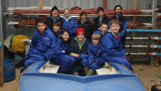 Pupils, staff staff prepare their new dinghy
