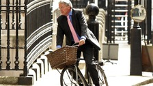 Andrew Mitchell arriving at Downing Street on his now infamous bike