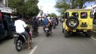 People riding motorbikes and cars packed the street in Banda Aceh after a strong earthquake struck Indonesia