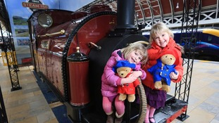 Three-year-old Alexandra Brimmer (left) and five-year-old Imogen Brimmer pose on the Princess, the world's first narrow gauge steam engine.