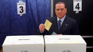Silvio Berlusconi, casting his vote, above, is neck and neck with the main centre-left party.