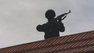 A masked member of the Al Aqsa Martyrs Brigade