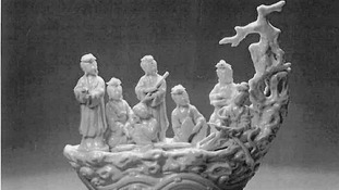 A Dehua porcelain figurine stolen during the raid.