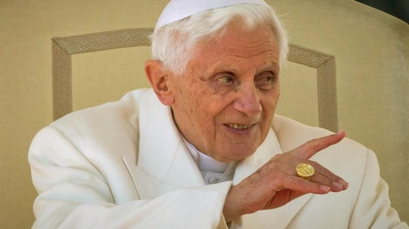 Pope Benedict XVI speaks to tens of thousands of pilgrims and well-wishers during his final weekly Wednesday General Audience