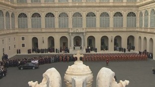 Cardinals, nuns and the Swiss Guard gather to see Pope Benedict XVI leave The Vatican.