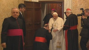 The cardinals say goodbye to Pope Benedict XVI.