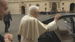 Pope Benedict XVI waves as he gets into a car to leave The Vatican.