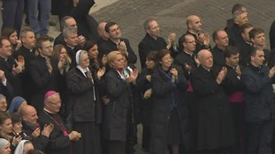 Well-wishers applaud Pope Benedict XVI.
