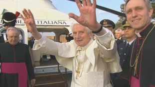 Pope Benedict XVI waves as he leaves for the Italian town Castel Gandolfo.
