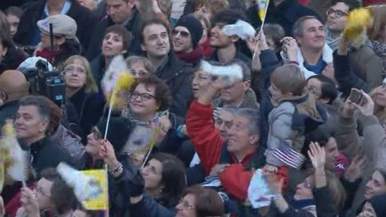 The crowds wave flags and cheer as Pope Benedict XVI arrives at Castel Gandolfo.