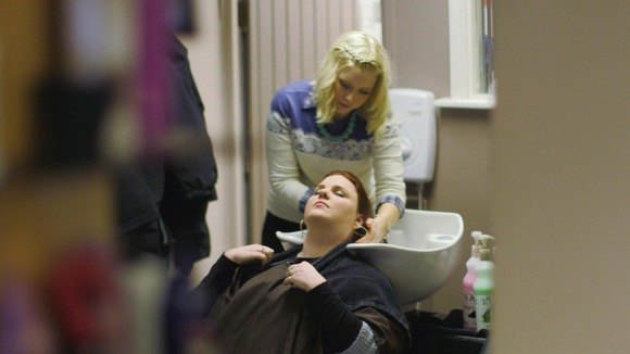 Lady washes hair in a salon