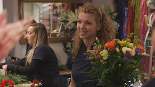 Woman at work in florists