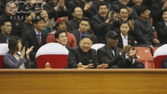 Kim Jong-un laughs with Dennis Rodman while watching a basketball game in Pyongyang.