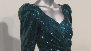 A glittering sea-green sequinned gown, designed by Catherine Walker.